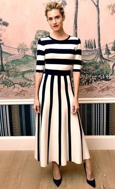 Allison Williams in a black and white striped dress