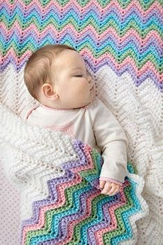 Bright Baby Blankets - For colorful blankets that will delight Baby, choose from the fun crochet designs in Bright Baby Blankets, featuring Red Heart yarns. Best-selling Super Saver comes in more than 100 wonderful colors. Soft Baby Steps is the ultimate yarn for babies in fresh, no-dye-lot solids and coordinating prints. Sweetest of all, Buttercup has tiny pom-poms of color blended with a fleecy yarn that is squeezably soft. Projects include Hexagon Baby Blanket, Squares ín Squares Baby…