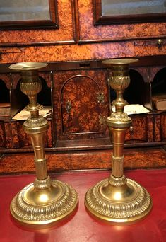 A good pair of early 19th. century French Gilt Brass or Ormolu fancy candlesticks.  Circa 1820
