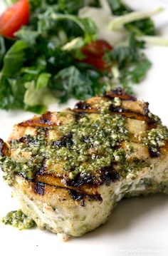 Grilled Halibut with Pesto Sauce Recipe From Scratch White wine and pesto sauce add a fresh flavor to traditional halibut. Grill them up and serve as steaks or wow your friends and make them an appetizer. Grilled Halibut Recipes, Grilled Seafood, Salmon Recipes, Recipes With Pesto, Tilapia Recipes, Grilled Salmon, Halibut Steak Recipe, Orange Recipes, Chicken Recipes
