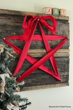 How-To: Reclaimed Wood and Ribbon Star Decoration...could use this with my sash from my wedding.....add to wedding wall...maybe