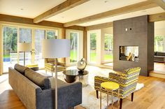 Like the interior design and finish. Incluing the yellow chair!  Contemporary Barn Home by Yankee Barn Homes