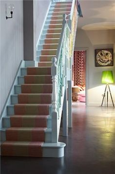 Eclectic Staircase - runner colours pick up just seen sitting room beyond. Love the blue steps - not sure about the multicoloured railing. Muted grey walls keep colours under control. Love the wall light. Style At Home, Interior Design Inspiration, Home Decor Inspiration, Design Ideas, Staircase Runner, Pastel Interior, House Stairs, Industrial, Interior Design Companies