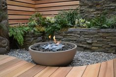 """Hemi 26"""" Fire Pit in garden setting by Solus Décor  This would work well for my small courtyard"""