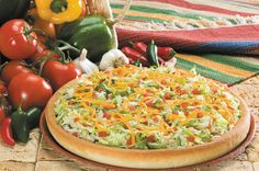 Got a craving for something south of the border? The Taco Pizza is the only pizza that starts with a spicy taco sauce and is topped with beef, onions, lettuce, tomatoes, cheddar, and mozzarella cheese to create a unique flavor guaranteed to satisfy your craving. #pizza #godfatherspizza