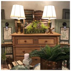 Antique pine dresser anchors this shop vignette with vintage brass lamps, antique shutters, and a pair of repurposed armoire doors now in a botanical themed wall light. Pine Dresser, American Decor, Brass Lamp, Shutters, Vignettes, Repurposed, Entryway Tables, Wall Lights, Doors