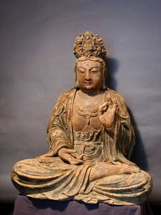 Wooden Sculpture of a seated Guanyin - X.0712 Origin: China Circa: 17 th Century AD Collection: Chinese Style: Late Ming- early Qing Medium: Wood