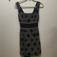 French Connection Daisy Rays Navy Strappy Dress Size 6.  New with Tags.  Sat in my closet for years.  Navy cotton dress with white embroidery and ribbon tie in the back.  FCUK runs very small. I equate this to a size 2. French Connection Dresses