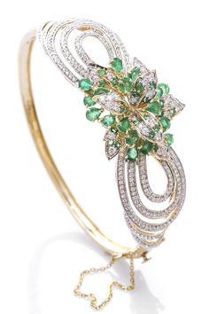 Emerald and diamond bow bangle bracelet