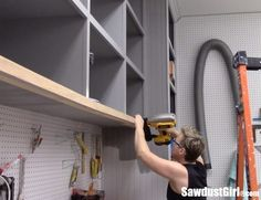 Easy DIY Sliding Doors for Cabinets - Sawdust Girl® - Sliding Cabinet Door Hardware, Sliding Door Panels, Sliding Garage Doors, Diy Cabinet Doors, Wooden Garage Doors, Modern Sliding Doors, Diy Cabinets, Double Doors, Panel Doors