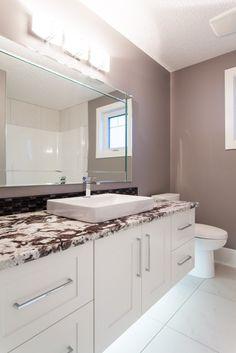 Granite washroom - Delicatus Vintage granite countertop with Eased edge profile.