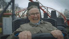 A grandmother riding a roller-coaster for the first time in her life