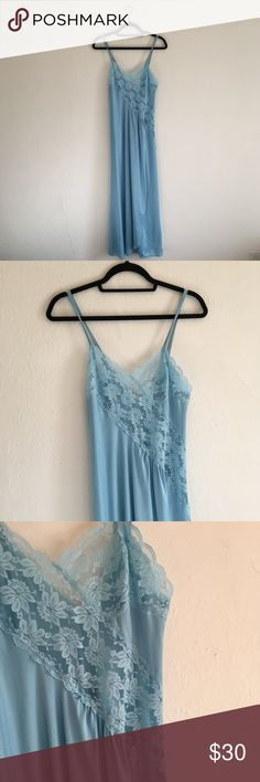 """Vintage Lace Satin Nightgown Slip Pretty lace & satin night gown 🎀 Double spaghetti straps. Slit on left side that goes all the way up! 🙀 no label or size marked. Fits a medium body best. this thing is both beautiful and sexy! Perfect condition.  Length 55"""" Bust 28""""  All sales final.  #nightgown #lace #babyblue #70s #80s #valentinesday Intimates & Sleepwear Chemises & Slips"""