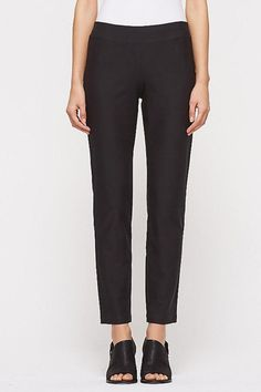Slim Ankle Pant with Yoke in Washable Stretch Crepe in Black. A pant that's easy enough for the plane and refined enough for the office. Stretch is the key. Slim fit, skims the leg and narrows slightly at the ankle. 1 3/4-inch elastic waistband. 9-inch rise, 28 1/2-inch inseam (size small). The fabric to move in. A French crepe knit with stretch and resilience since 2002. Slim Ankle Pant by Eileen Fisher. Clothing - Bottoms - Pants & Leggings Canada