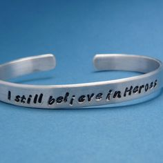The Avengers Inspired - I Still Believe In Heroes - A Hand Stamped Aluminum Bracelet. $14.95, via Etsy.