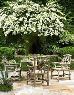 Ivy Clad: Outdoor Living Space with Debra Phillips - love the flagstone with the faux bois furniture sitting on top Outdoor Areas, Outdoor Rooms, Outdoor Dining, Outdoor Furniture Sets, Outdoor Decor, Patio Dining, Wooden Furniture, Dining Set, Outdoor Seating