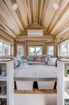 This is the Clover Tiny House on Wheels by Modern Tiny Living. With poplar throughout, concrete countertops, a full gourmet kitchen, full bath, and Modern Tiny Best Tiny House, Modern Tiny House, Tiny House Cabin, Tiny House Living, Tiny House Plans, Tiny House On Wheels, Tiny House Bedroom, Modern Houses, Living Room