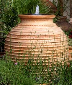 Water Features  Ribbed pots make captivating water features. You will find 4 pots converted and a millstone conversion to inspire you. The ambience of gentle water flowing makes a unique addition to any garden. Choose your pot and we can do the full conversion for you supplying a round reservoir, pump with a 3 year guarantee, fittings and instructions, leaving you or your landscaper merely to install it.