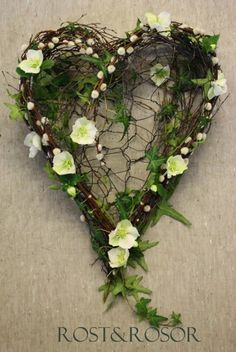 A heart shaped wreath perfect to adorn your princess on the head with. The white flowers go well with the overall pure look of the crown as well as the artistically messy set up of the leaves and vines.