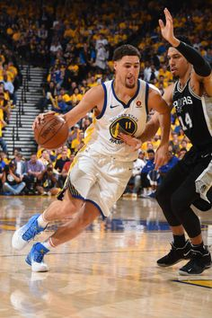 Klay Thompson of the Golden State Warriors handles the ball against the San Antonio Spurs in Game Five of Round One of the 2018 NBA Playoffs on April...