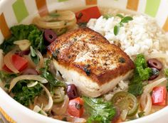 """Halibut Veracruzana - """"I love the simplicity of this dish,"""" says chef Mary Sue Milliken. """"It's so easy to make and these few ingredients make such a statement! No ingredient cooks for long and it comes together in about 12 minutes. The colors of the dish are great, too—red tomatoes and good-quality black olives—and the fish has a great, golden brown sear.""""  In Alaska, fishing for halibut is limited to bottom longlining, which causes little habitat damage or bycatch, making it a """"Best…"""