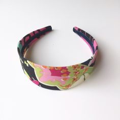 J. Crew Floral Patterned Headband This J. Crew Headband is slight worn with no signs of wear. The pattern includes the following colors: lime green, orange, pink, navy, and aqua. Cute for spring/summer! J. Crew Accessories Hair Accessories