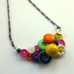 Colorful Daisy Necklace Bright Button Jewelry This necklace is a combination of bright multi-color vintage buttons with beads on white wire.  by buttonsoupjewelry, $30.00