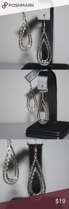 Beautiful Sterling silver dangle earrings 2 inches long! Stunning sterling silver stamped .925 french hook dangle earrings Buy from me with confidence! I have sold over 500 items with a 5 star rating! If you have any questions, do not hesitate to ask.  Looking at a few things in my shop? Put a bundle together, comment on an item that you are ready to check out and let me send you an even better offer!  Thank you for visiting :) Free gifts with every purchase! Jewelry Earrings