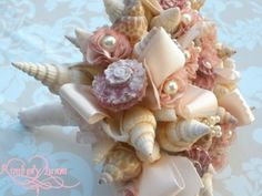 Pearls + Seashells = a different twist on the bridal bouquet. Love it. www.diamonds.pro