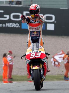 Marc Marquez Photos - Marc Marquez of Spain and Repsol Honda Team celebrates the victory at the end of the MotoGP race during the MotoGp of Germany - Race at Sachsenring Circuit on July 2015 in Hohenstein-Ernstthal, Germany. - MotoGp of Germany - Race Marc Marquez, Motogp Race, Vintage Mustang, Motosport, Sportbikes, Valentino Rossi, Bike Life, Ducati, Quad