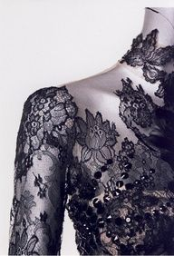 Not a tattoo, note fold in lace on sleeve, lace on illusion fabric?