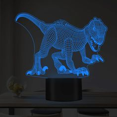 This is a decorative Dinosaur visual LED night light, touch switch, have 7 colors light-changeable. It can be powered by the provided USB cable or 3 * AAA batteries (not provided) under different situations, flexible and user-friendly. Jungle Room, Light Touch, 3d Shapes, Lampe Led, Led Night Light, Birthday Cakes, Light Colors, Holiday Gifts, Illusions