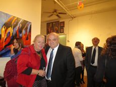 """U.S. Federal Immigration Justice Elizabeth Lamb (l) and Dr. Dennis Selmont, Ph.D (r) at the """"Moulin Rouge-Thanksgiving"""" Gala Champagne Reception for the November 8 - December 3, 2013 Exhibition at Amsterdam Whitney Gallery"""