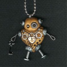 Cute steampunk robot heart necklace