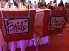 Bride and Groom chair signs at wedding.