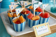 Look for cupcake wrappers and skewers that would work with color scheme.