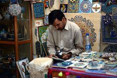 Artisan working on his shop/lab in Yazd