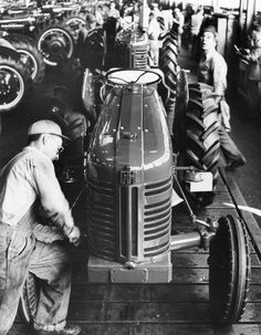International Farmall 300 Assembly Line | Photograph | Wisconsin Historical Society Vintage Tractors, Antique Tractors, Vintage Farm, Farmall Tractors, Ford Tractors, International Tractors, International Harvester, Assembly Line, Farm Pictures