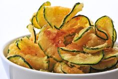Zucchini Chips Recipe - Perfect snack for school lunches, after school or work snacks, or as a side dish with meals. Calories: Total Fat: g Cholesterol: mg Sodium: mg Total Carbs: g Dietary Fiber: g Protein: g Zucchini Chips Recipe, Bake Zucchini, Zucchini Crisps, Healthy Zucchini, Fried Zucchini, Zuchinni Chips, Squash Chips, Spinach Chips, Zucchini Bites