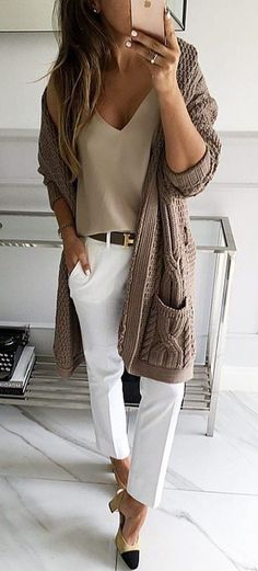 This outfit says casual & luxury at the same time for a cold winter office. The white trousers, taupe colored camisole, and long chunky knit cardigan with pockets dress it up & tone it down at once. If taupe and brown aren't your colors, switch out a light grey cami and charcoal duster with white trousers, and wear chunky heel loafers with a matching belt for all-day chic.