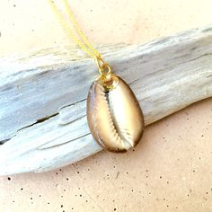 Ikaria // Verticle Brown Cowrie Shell Necklace, Gold Dipped Jewelry, Gifts under 30, Beach Jewelry by NesoiCollection on Etsy https://www.etsy.com/listing/225408935/ikaria-verticle-brown-cowrie-shell