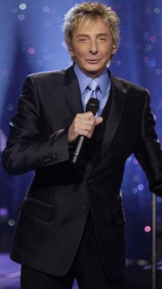 Barry Manilow in a blue suit.