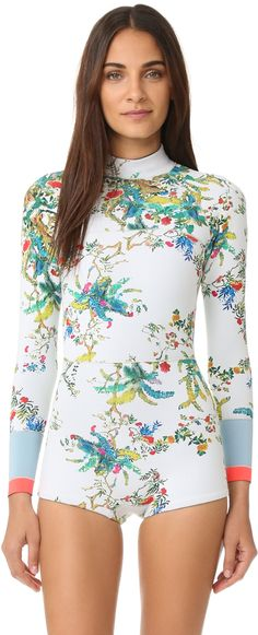 Cynthia Rowley Rainbow Vines Wetsuit - A bold Cynthia Rowley wetsuit made from slick neoprene. Velcro® secures the high neckline. Covered zips secure the back closure and pocket. Long sleeves. Unlined. Shell: 100% nylon. Trim: 80% nylon/20% spandex. Hand wash.