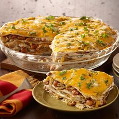 Give leftover cooked chicken new life with this casserole of flour tortillas layered with chicken, beans, salsa verde and shredded cheese.