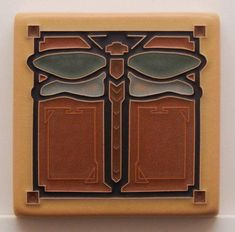 By Arts and Craftsman Tileworks. This is a Ceramic Dragonfly Tile in Green Oak in a size made by Arts and Craftsman Tileworks. After many years of woodworking, Arts and Craftsman Woodworks has finally branched out into making tiles. Craftsman Style Decor, Craftsman Frames, Craftsman Tile, Craftsman Fireplace, Craftsman Furniture, Modern Craftsman, Craftsman Kitchen, Craftsman Bathroom, Craftsman Cottage
