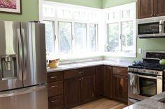 Sensa Silver Silk Granite, Walnut Cabinets, Maple Floor, LG appliances, Andersen windows.  I love my kitchen!