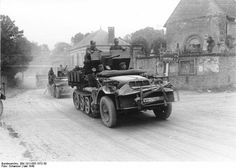 Found this great picture on Bundesarchives. German convoy passing through a French village The sign seen on the roadside possibly has been bent back but it could be Fère-Champenoise and Euvy which could mean that the convoy is passing through Gourgançon. That would place them around 80km south of Reims. Probably taken around early June 1940