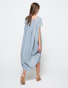 A lightweight, short-sleeved linen dress in sky blue