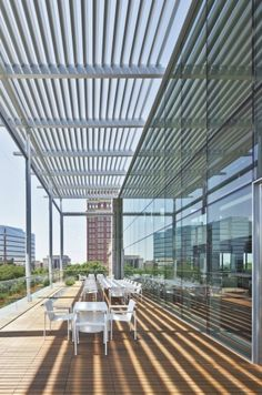 A high-performance curtain wall and glazing system in order to prevent solar heat gain and glare from the west.