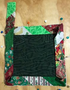 Quilting A Strip-Quilted Potholder - A Tutorial Quilting A Strip Pieced Potholder with bias binding, A FREE E Course is available now! for learning how to make this potholder with foundation strip piecing and strip pieced bias binding. Quilting Projects, Sewing Projects, Quilting Ideas, Quilting 101, Fun Projects, Sewing Hacks, Sewing Ideas, Crochet Granny Square Afghan, Granny Squares